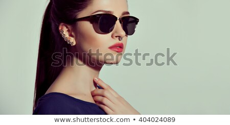 Portrait of young brunette girl with nose earring Stock photo © dashapetrenko
