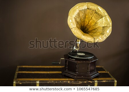 Old gramophone with horn speaker stands against anicent background, produces songs recorded on plate Stock photo © vkstudio