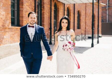 бородатый мужчины жених формальный черный костюм невест Сток-фото © vkstudio