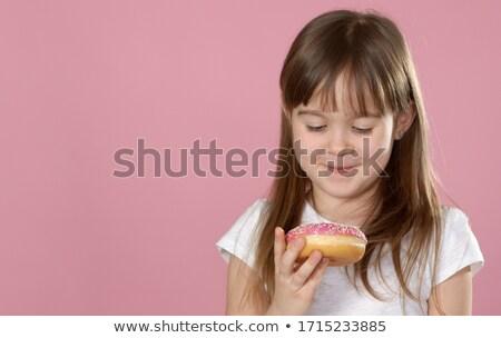 Studio portrait belle petite fille donut Photo stock © dash