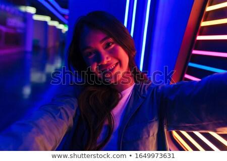 Boldog optimista pozitív nő pózol neon Stock fotó © deandrobot