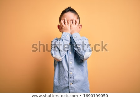 ashamed boy stock photo © lovleah