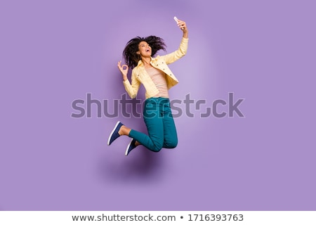 Showing sign woman jumping stock photo © Maridav