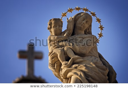 Isolated statue of Mary with cross Stock photo © backyardproductions