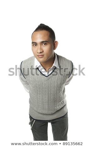 Friendly asian man leaning forward in casual clothes on white background. stock photo © palangsi
