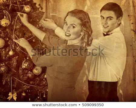 christmas party beautiful women preparing christmas tree retro stock photo © lordalea