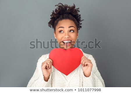 Isolated portrait of a beautiful female holding heart stock photo © Anna_Om
