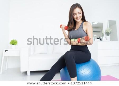 barna · hajú · tornaterem · egyensúlyozó · labda · nő · nők · kék - stock fotó © photography33