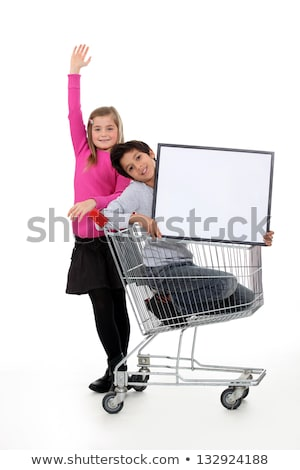 Children in a shopping trolley with a blank board Stock photo © photography33