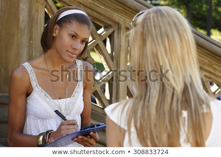 Woman with clipboard interviewing Stock photo © photography33