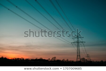 eletricidade · pôr · do · sol · laranja · céu · ambiental · dano - foto stock © microolga