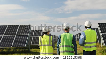 Stockfoto: Specialist In Electricity With Customer