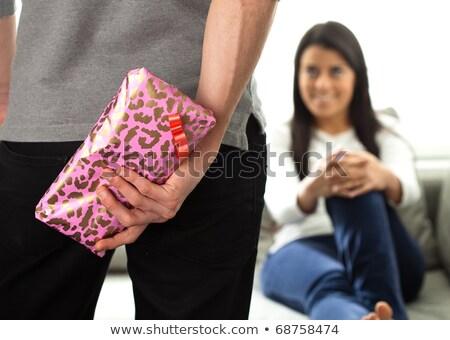 Junger Mann bietet Geschenk Freundin Weihnachten Mädchen Stock foto © photography33