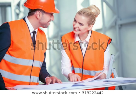 Homme travailleur de la construction pointant doigt affaires femme Photo stock © photography33