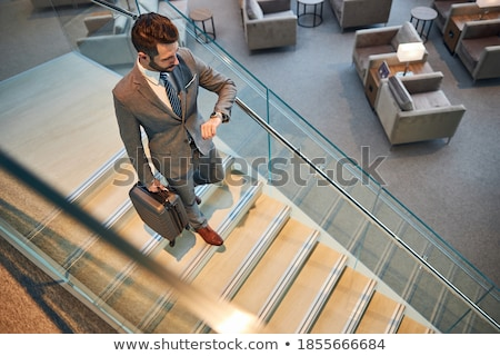 Man waiting with arm on railing stock photo © Schmedia