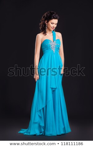 fashion style graceful woman in classic long cyan dress posing stock photo © gromovataya