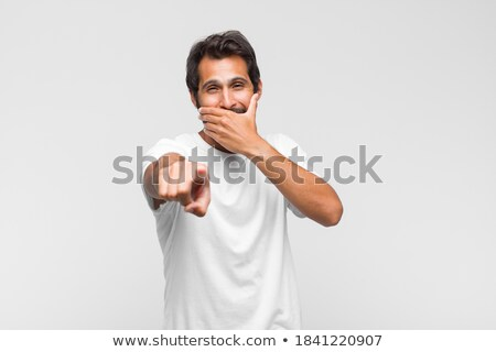 young man laughing at camera isolated stock photo © juniart