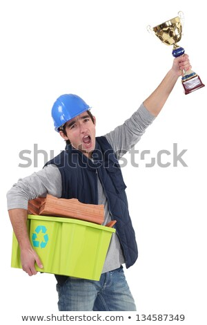 Builder with a trophy recycling material Stock photo © photography33