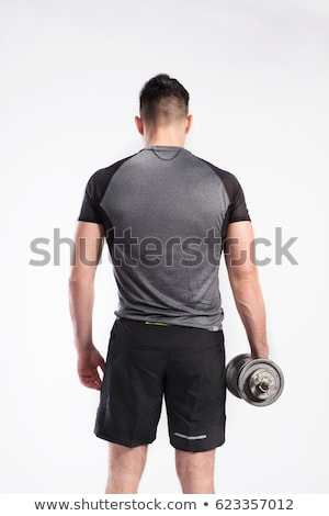 dumbbell man rear view with back muscles stock photo © lunamarina