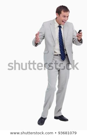 Businessman getting good news via text message against a white background Stock photo © wavebreak_media