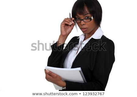 portrait of black businesswoman with glasses lowered holding notebook stock photo © photography33