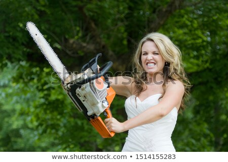 pretty girl with chainsaw stock photo © aikon