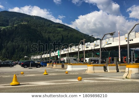 Toll motorway road in Europe in a sunny blue day with clouds Stock photo © lunamarina