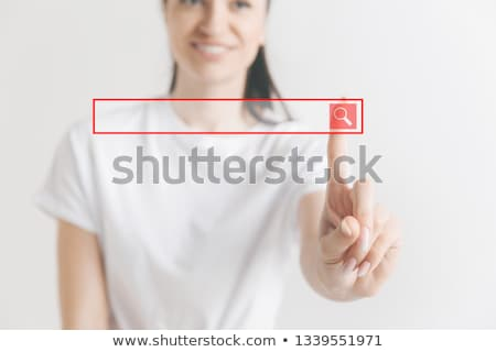 Stock photo: futuristic businesswoman finger touching pad