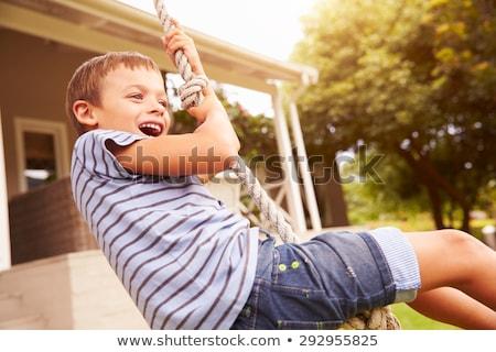 Stockfoto: Jongen · swing · gelukkig · glimlachend · park · speeltuin