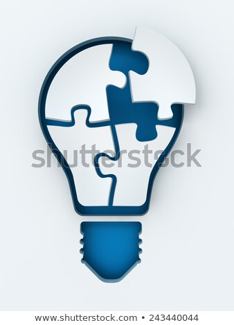 Stok fotoğraf: Light Bulb Icon On Blue Puzzle