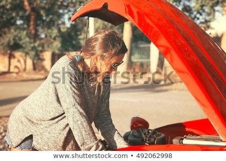Nő javít autó visel fekete szoknya Stock fotó © sumners