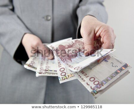 Human hand holding swedish money Stock photo © mikdam