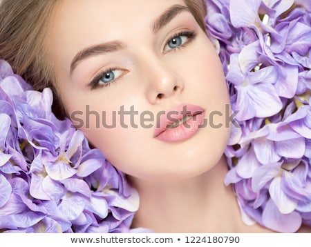 Portrait of beautiful young blond woman with clean face on blue  Stock photo © hasloo