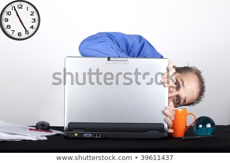 business man hide behind laptop and documents stock photo © sebastiangauert