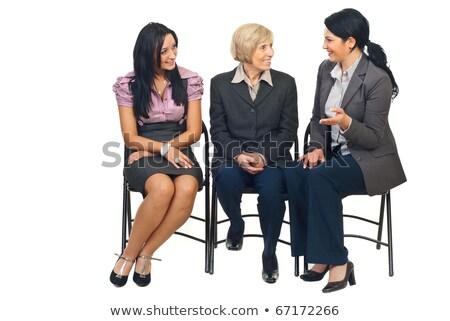 group of people sitting on chairs and having conversation stock photo © kirill_m