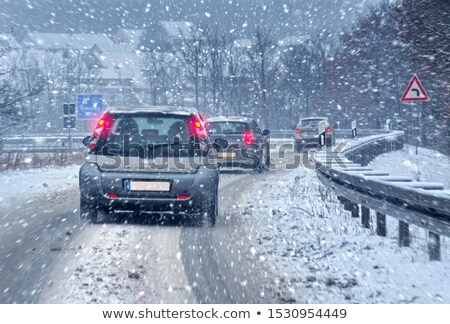 Traffic and Snowstorm on the Highway stock photo © aetb
