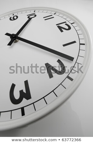 Stock fotó: White Clock With Black Hands Showing Eight Past Ten