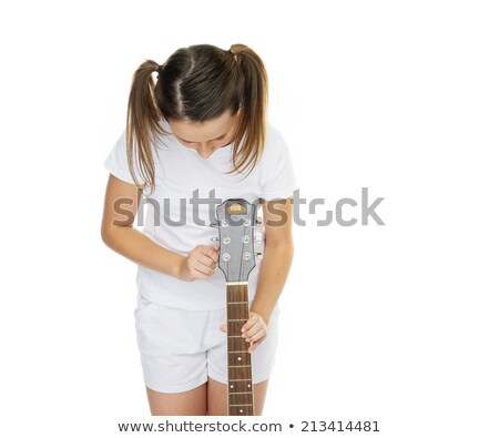 Girl in pigtails tuning guitar Stock photo © stryjek