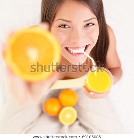 gyönyörű · barna · hajú · pohár · narancslé · áll · konyha - stock fotó © dash
