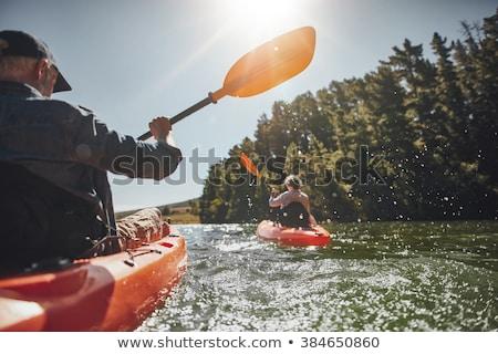 старший мужчины каноэ озеро поздно лет Сток-фото © PixelsAway