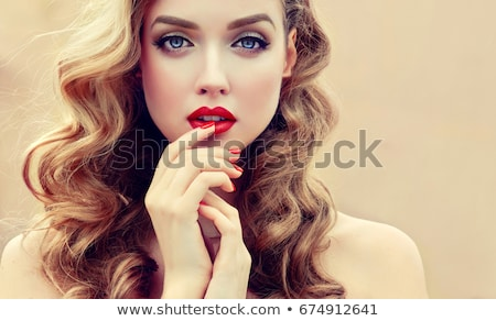 Woman with beautiful red manicured nails Stock photo © juniart