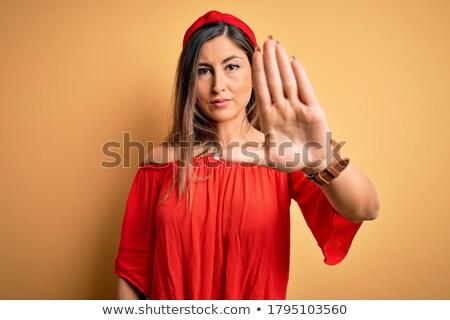 Young serious woman stock photo © gemenacom