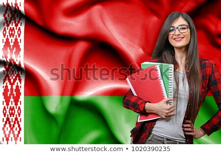 Happy female student holding flag of belarus Stock photo © deandrobot