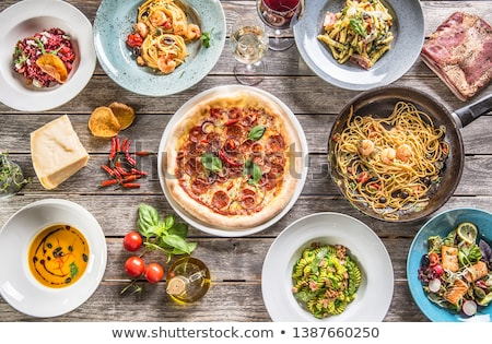 Table full of meals and wine Stock photo © HASLOO
