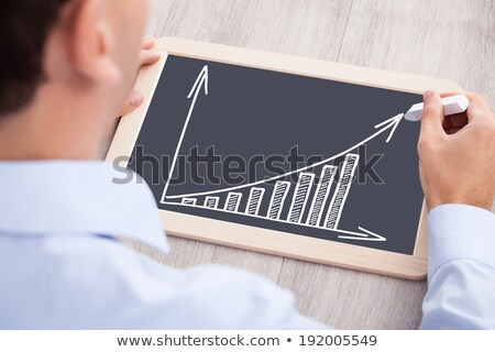 Businessman With Slate And Chalk At Desk Stock photo © AndreyPopov