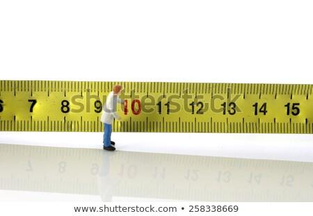 Uomo occupato misurazione strumento isolato bianco Foto d'archivio © compuinfoto
