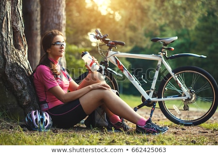 woman with bike drinking water stock photo © Flareimage