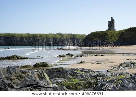 ballybunion castle ruins with surf school stock photo © morrbyte