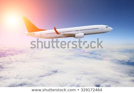 Repülés repülőgép felhők fehér égbolt naplemente Stock fotó © ssuaphoto