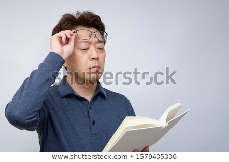 presbyopia myopia reading glasses Stock photo © sirylok